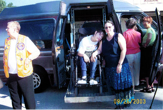 Everyone's admiring the fully loaded handicapped accessible van that was donated by Mr. & Mrs. Brent Smith.